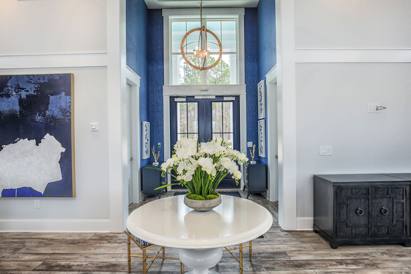 Royal Blue Doors with white orchids and marble table home design