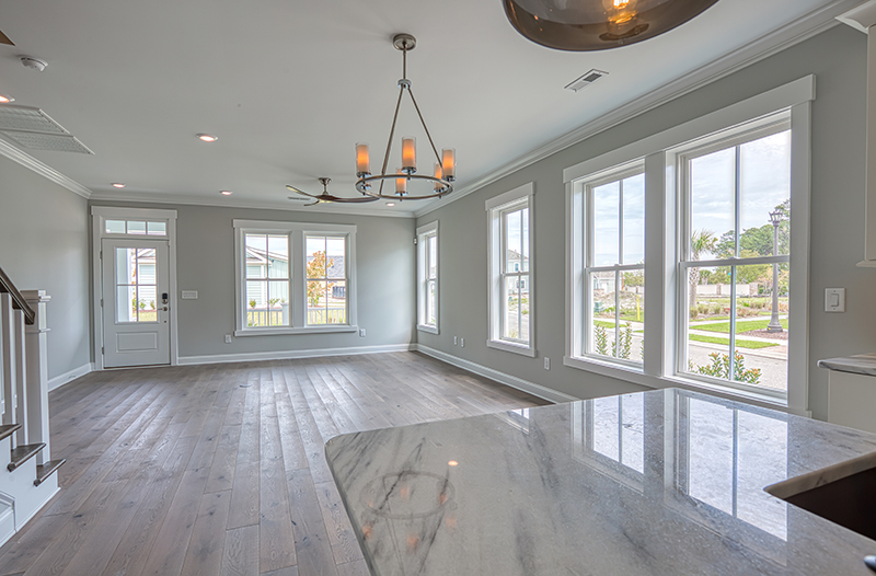 Wood floors windows living to kitchen