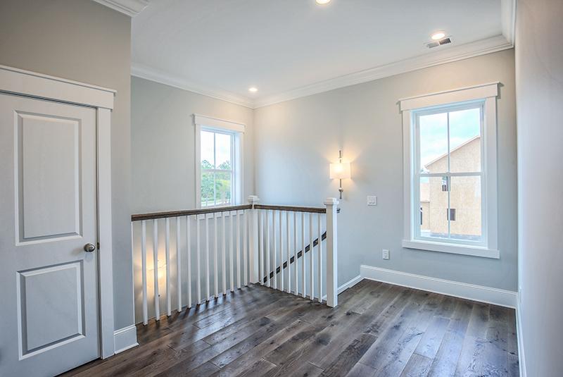 Upstairs banister wood floors grey walls