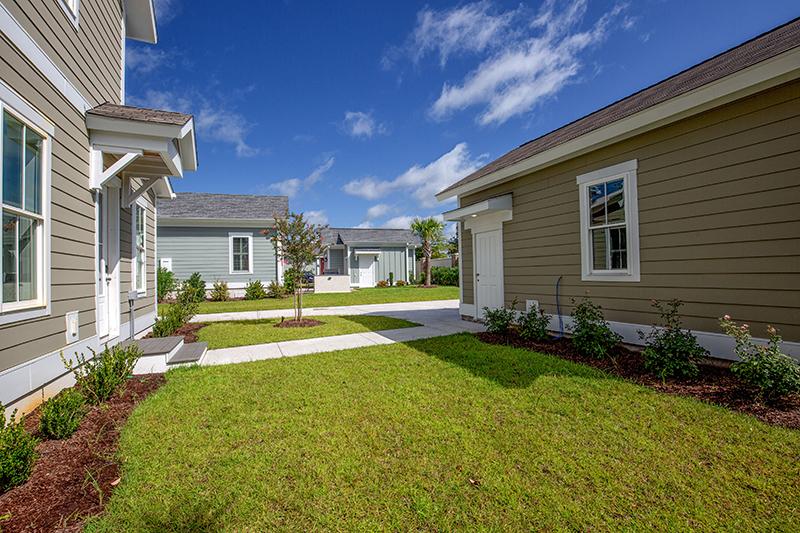 Green grass courtyard between garage and house